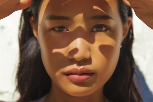 woman with sun in face