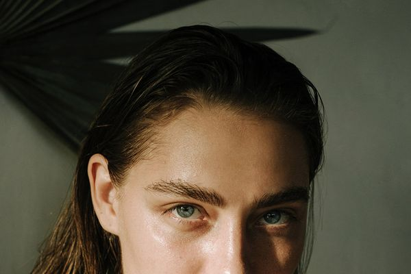 Woman with blue eyes and bold eyebrows
