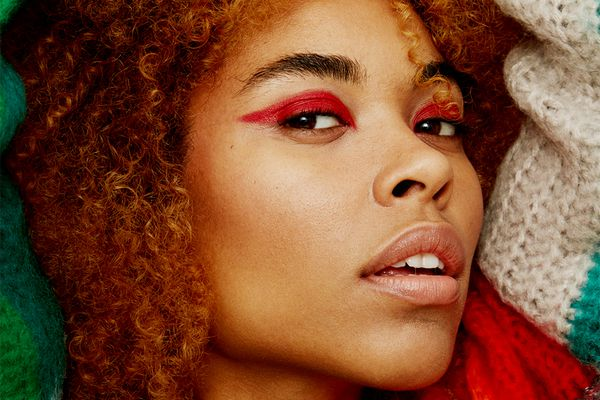 closeup portrait of person with red eyeshadow liner