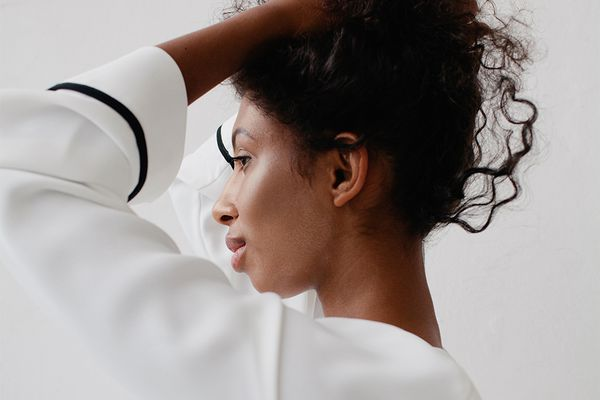 black femme with hands in hair