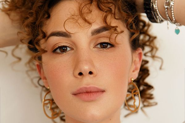 woman holding curly hair
