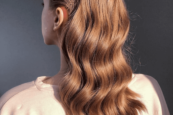 back of woman's head with long red hair