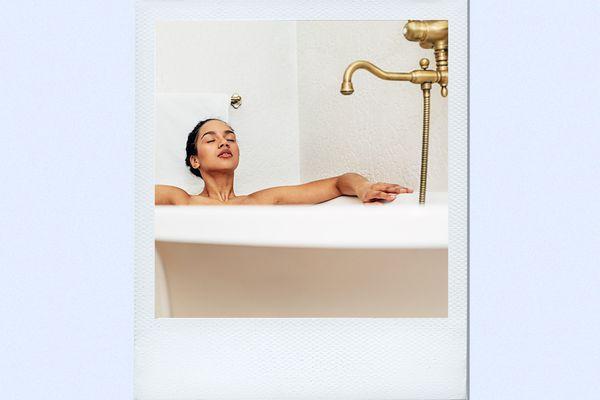 woman sitting in bath