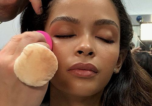woman getting her makeup applied