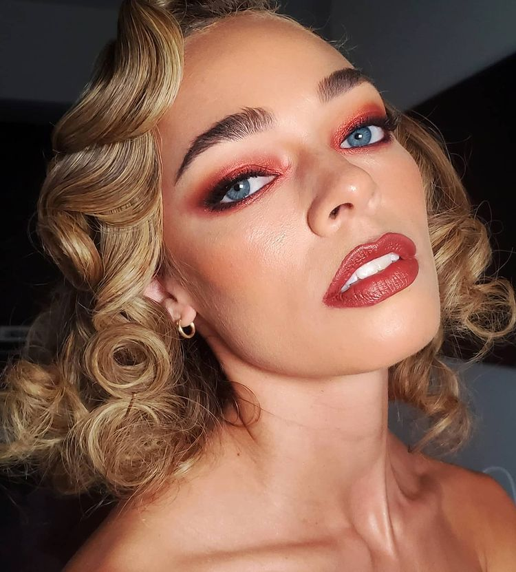 Desert ruby eye makeup and lips with curly bob