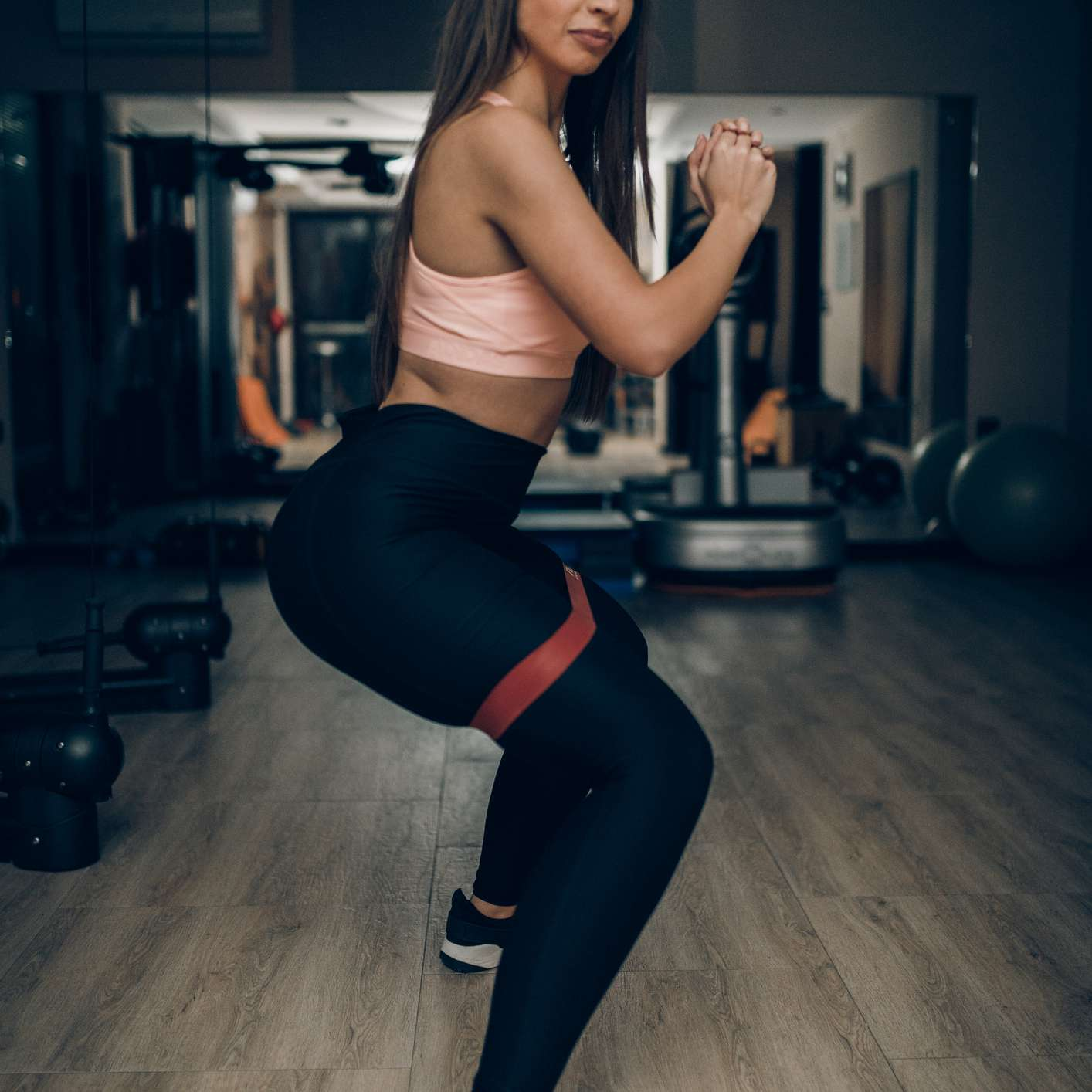 woman with resistance band around thighs