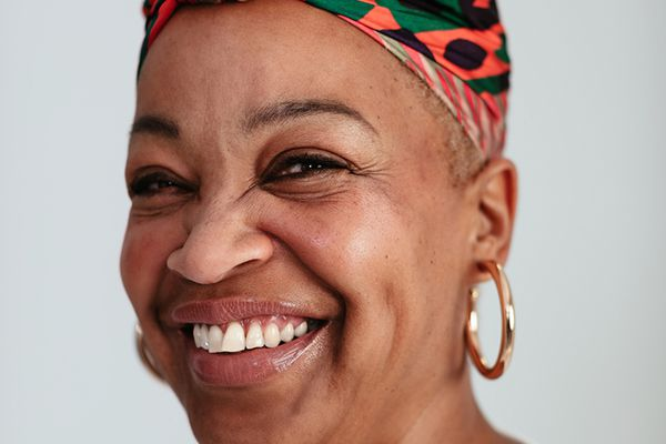 woman smiling with head wrap
