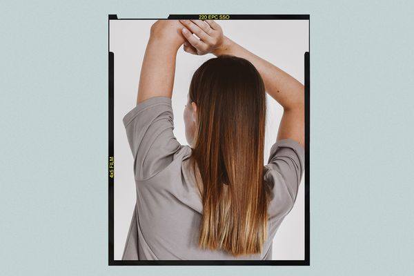 Woman with shiny, healthy hair, viewed from the back