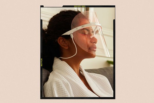 woman with a led therapy mask
