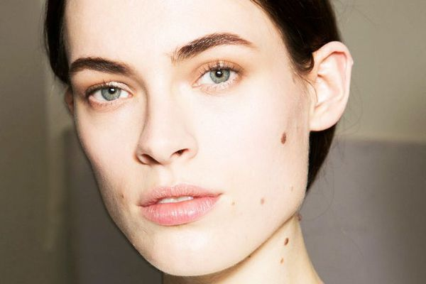 Girl with clear, wrinkle-free skin