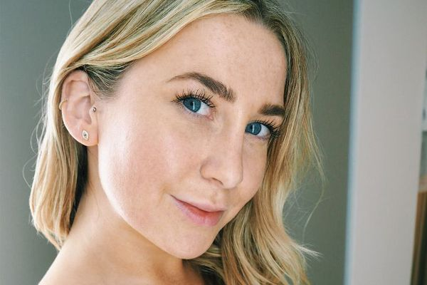 Woman with minimal makeup, blue eyes, and blonde hair